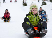 Sledging in Leukerbad - a different kind of downhill fun for young and old