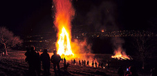 Traditional Funkensonntag bonfire in Mäls neat Balzers