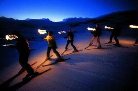 ski-run with torches in Bellwald